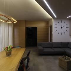 ISPIRAZIONI SCANDINAVE: Sala da pranzo in stile  di ARCHITÈ