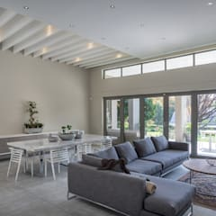 Houghton Residence - Modern Interior Design:  Living room by Dessiner Interior Architectural