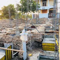 Footing Concrete Works:  Multi-Family house by Cfolios Design And Construction Solutions Pvt Ltd