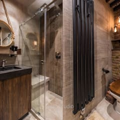 industrial Bathroom by GraniStudio
