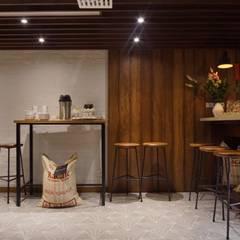 Local Racafé : Centros de exhibiciones de estilo  por AMR ARQUITECTOS