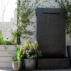Fuente tipo pared: Jardines de estilo  de La Habitación Verde