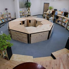 Offices & stores by INTERIOR BOOKWORM CAFE