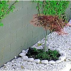 Jardins de pedras  por paisajistas y jardineros