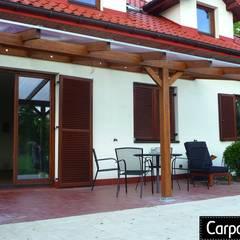 zadaszenie tarasu: styl , w kategorii Taras zaprojektowany przez P.H.U. Carport Planet Konstrukcje Drewniane