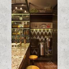 Loft do Cervejeiro - Campinas Decor 2016 por CASARIN MONTEIRO ARQUITETURA & INTERIORES Industrial Granito