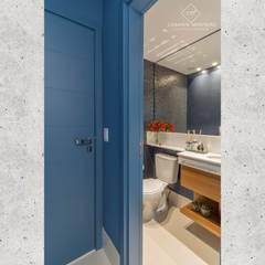 Hall e Lavabo: Banheiros  por CASARIN MONTEIRO ARQUITETURA & INTERIORES