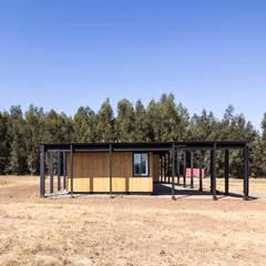 Casa Picarquín: Casas de madera de estilo  por Crescente Böhme Arquitectos