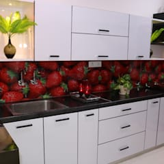 Kitchen units by Enrich Interiors & Decors,