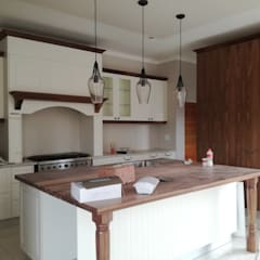 ​Off white and walnut solid wood:  Built-in kitchens by Première Interior Designs