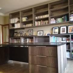 bookshelf + study desk: modern Study/office by Première Interior Designs