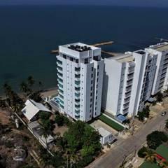 EDIFICIO OCEANÍA COVEÑAS: Casas multifamiliares de estilo  por mínimal arquitectura