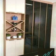 Aline Dinis Arquitetura de Interioresが手掛けたキッチン収納,