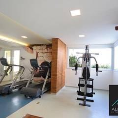 Academia do condomínio: Fitness  por Aline Dinis Arquitetura de Interiores