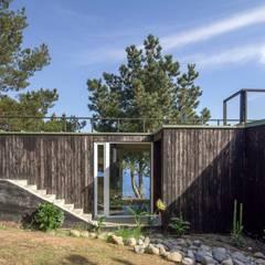 Casas de madera de estilo  por Crescente Böhme Arquitectos