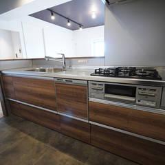 ヴィンテージテイストで上質な空間: セイワビルマスター株式会社が手掛けたキッチンです。