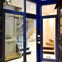 Glass doors by Công ty TNHH Thiết Kế Xây Dựng Song Phát