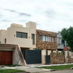 PROYECTO FINAL: VIVIENDA MULTIFAMILIAR WG: Casas multifamiliares de estilo  por PRIGIONI Arquitectura y Diseño