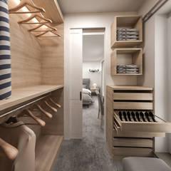 cabina armadio: Camera da letto in stile  di studiosagitair