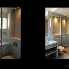appartement QDO: Salle de bains de style  par Laure van Gaver