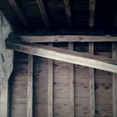 Vivienda en Algodon Comedores rústicos de Azcona Vega Arquitectos Rústico