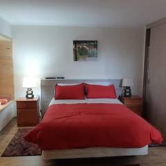 Convertimos una casa en mini hotel: Dormitorios de estilo  por Arquitectura & servicios aociados