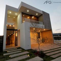 Casa Corti: Casas unifamiliares de estilo  por AFG Construcción y Diseño, Moderno