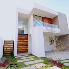 Single family home by AFG Construcción y Diseño