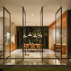 House of Inside and Outside: tropical Dining room by Tamara Wibowo Architects