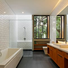 House of Inside and Outside: tropical Bathroom by Tamara Wibowo Architects
