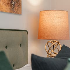 Master bedroom bedside lamp and buttoned headboard:  Bedroom by Timothy James Interiors