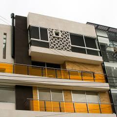 Edificio C57- Detalle penthouse y punto fijo: Paredes de estilo  por RIVAL Arquitectos  S.A.S.