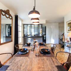 rénovation d'un appartement en duplex: Salle à manger de style  par ELB architecture d'intérieur