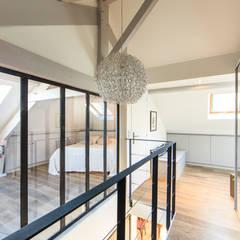 Escaleras de estilo  por ELB architecture d'intérieur