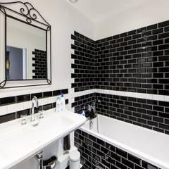 rénovation d'un appartement en duplex: Salle de bains de style  par ELB architecture d'intérieur