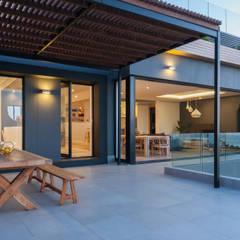 House Kai:  Patios by JBA Architects