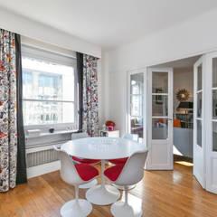 Une salle à manger classique et design: Salle à manger de style  par E.D. Décoration d'Intérieur
