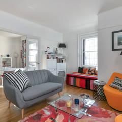Un salon cosy et lumineux ouvert sur la salle à manger: Salon de style de style Classique par E.D. Décoration d'Intérieur