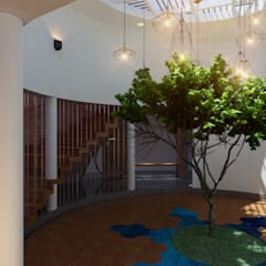 The Circular Courtyard House:  Corridor & hallway by S Squared Architects Pvt Ltd.