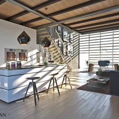 Zona Cucina  Open Spaca: Cucina attrezzata in stile  di Atelier116
