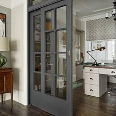 اتاق کار و درس by Tailored Living Interiors