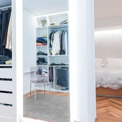 Vista vestidor_habitación: Vestidores de estilo  de MAGA - Diseño de Interiores