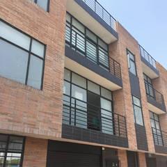 Edificio  Familia  hermanas Moreno : Casas multifamiliares de estilo  por Mogaj diseño y construccion s.a.s.