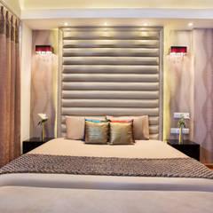 CENTRAL PARK RESORT APARTMENT, GURGAON:  Bedroom by Total Interiors Solutions Pvt. ltd.