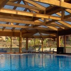 Piscinas infinitas de estilo  por Drevo - Construção e Reabilitação em Madeira, Unipessoal, Lda