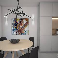 Woonhuis in Leiden. Klein huis, groots aangepakt.:  Eetkamer door Studio-em