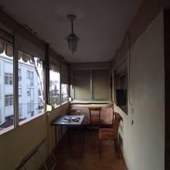 Terraza salón: Terrazas de estilo  de Almudena Madrid Interiorismo
