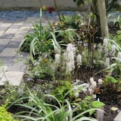 レンガと枕木小路の庭: 株式会社グリーンテリアが手掛けた庭です。