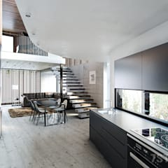 Kitchen and Lounge:  Living room by 7Storeys