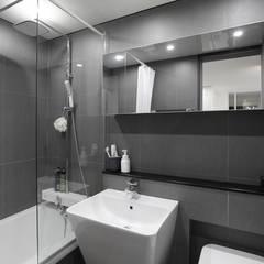 블랙&화이트 모던한 분위기의 평촌 초원2단지대림 아파트 32py : 홍예디자인의  욕실